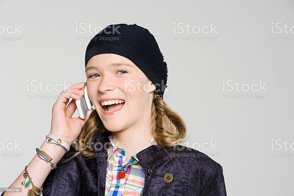 Teenage girl talking on cell phone 免版稅 stock photo