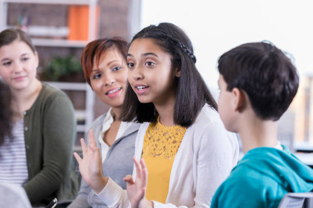 teenage girl talks in group therapy session - middle school teacher stock pictures, royalty-free photos & images