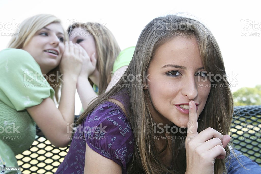 Teenage Girl Tells A Secret To Another royalty-free stock photo