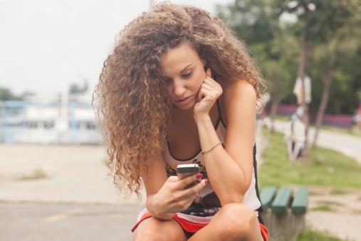 Teenage girl texting on the phone
