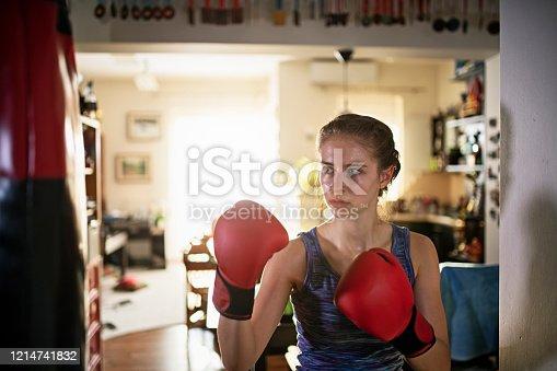 Teenage girl training boxing at home.  Nikon D850
