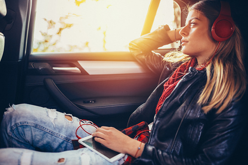 istock Teenage girl traveling with car 612723120