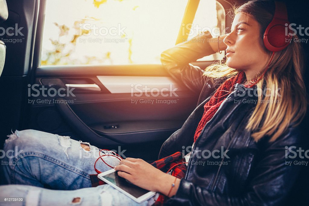 Teenage girl traveling with car stock photo