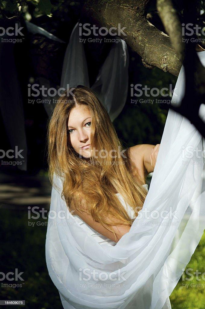 Teenage girl under tree stock photo