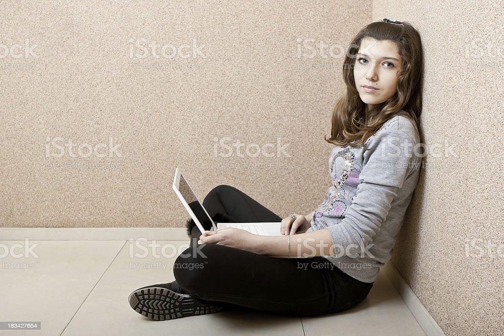 Teenage girl using laptop royalty-free stock photo