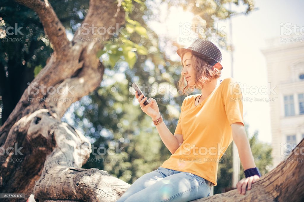 Teenage girl using smartphone stock photo