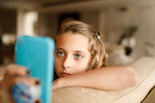 teenage girl using social media on phone - smartphone addiction not groups stock pictures, royalty-free photos & images
