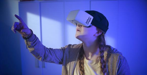 Teenage girl using virtual reality simulator
