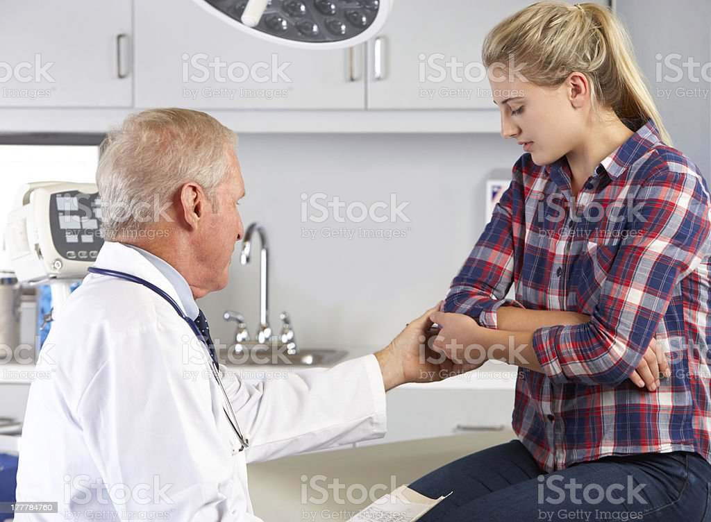 Teenage Girl Visits Doctor's Office With Elbow Pain royalty-free stock photo