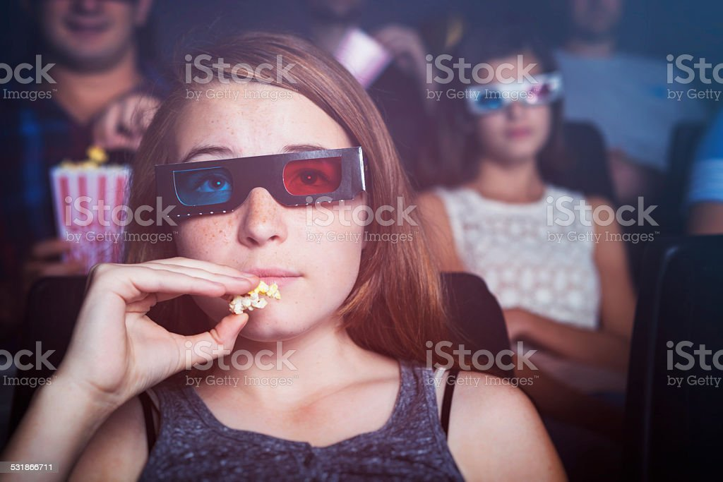 Teenage Girl Watching a 3D Movie stock photo