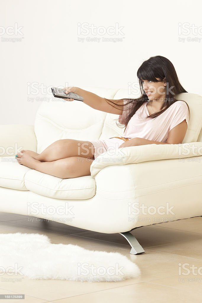 Teenage girl watching movie at home. royalty-free stock photo