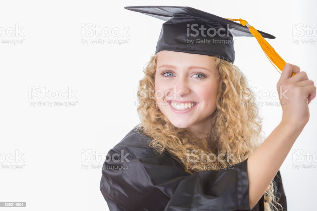 Teenage Girl Wearing Graduation Cap And Gown Turns Her Tassel Stock ...