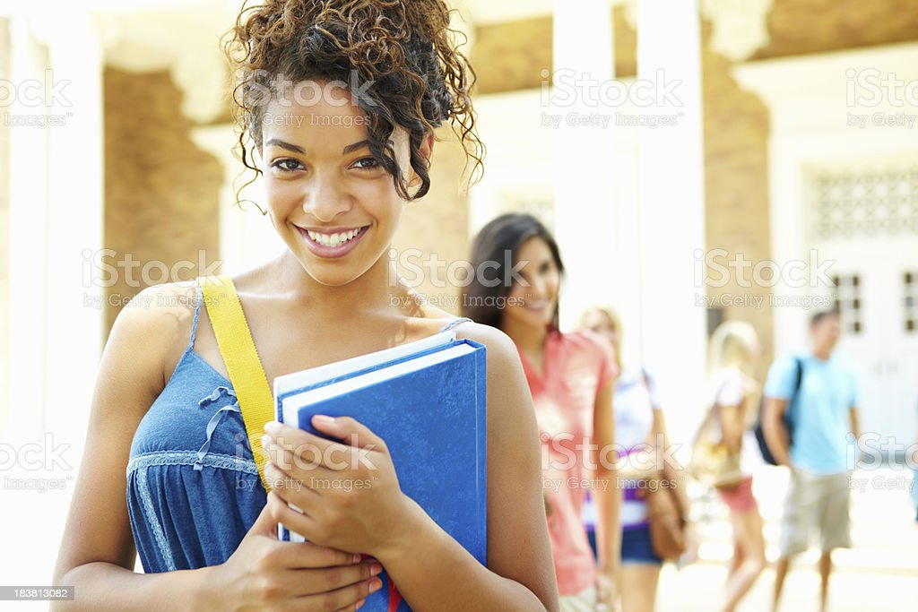 Teenage girl with backpack and books at campus royalty-free stock photo