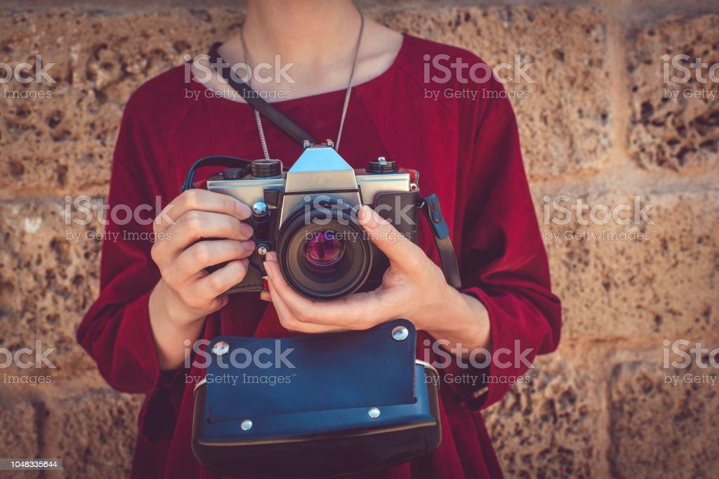 Teenage girl with camera stock photo