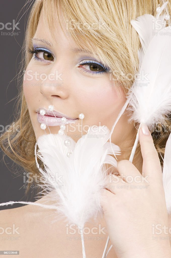 teenage girl with feather royalty-free stock photo
