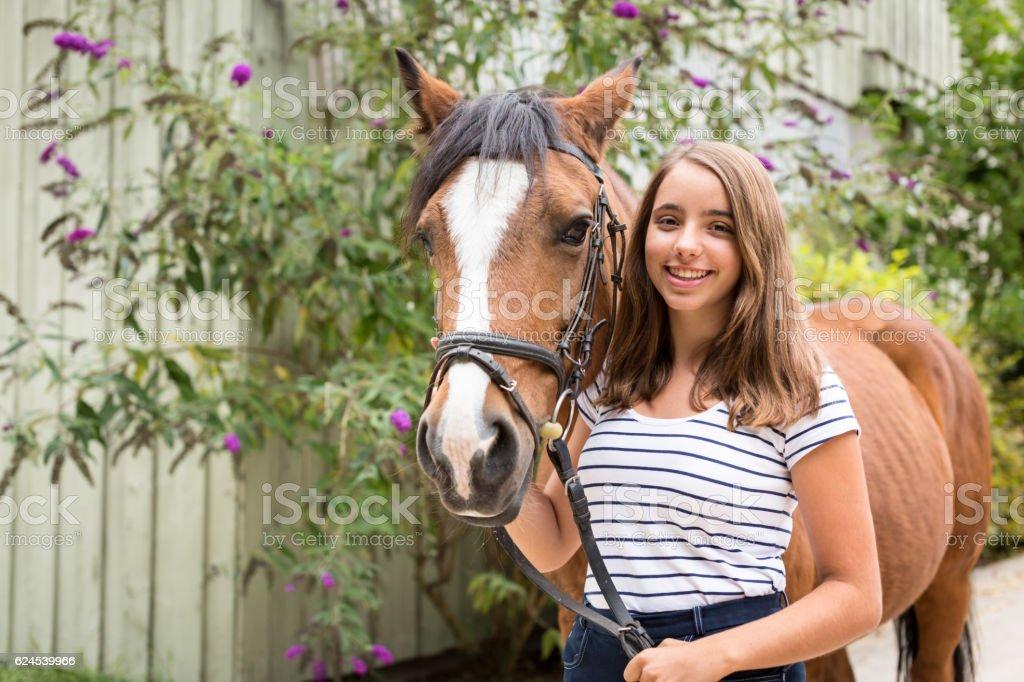 Teenage Girl With Her Pony stock photo