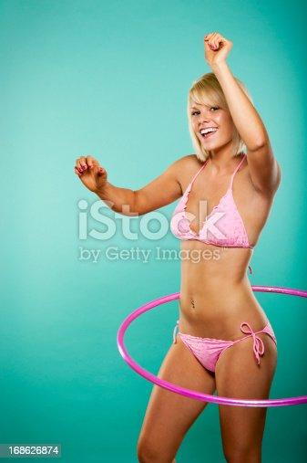 istock Teenage Girl with Hula Hoop 168626874