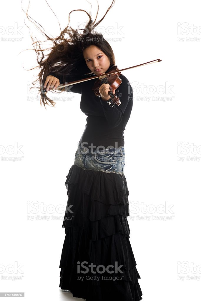 Teenage girl with long skirt playing violin stock photo