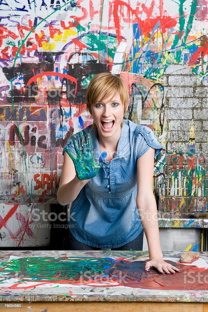 A teenage girl with paint on her hand stock photo