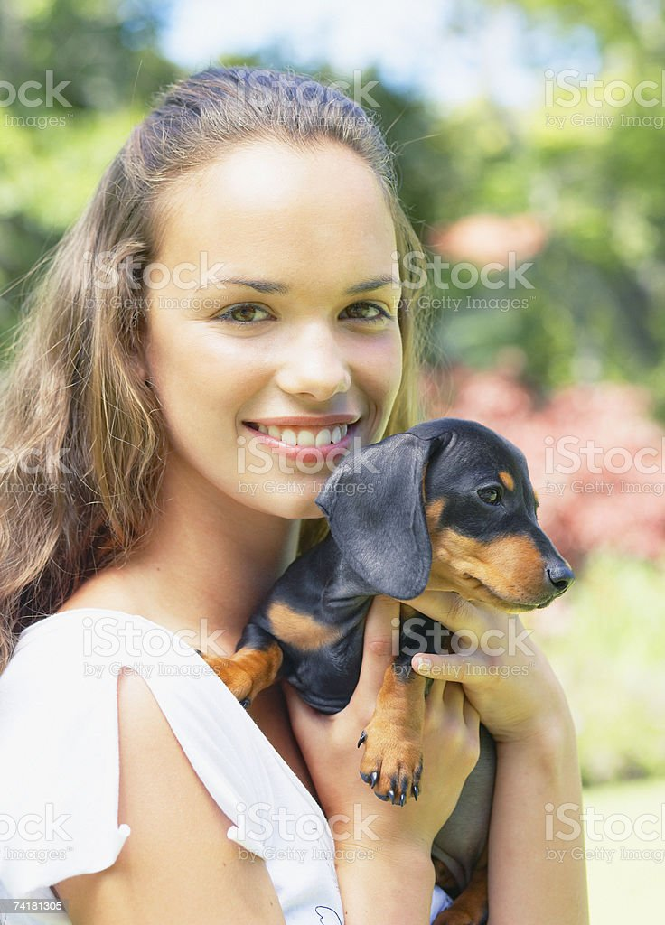 Teenage girl with puppy dog royalty-free stock photo