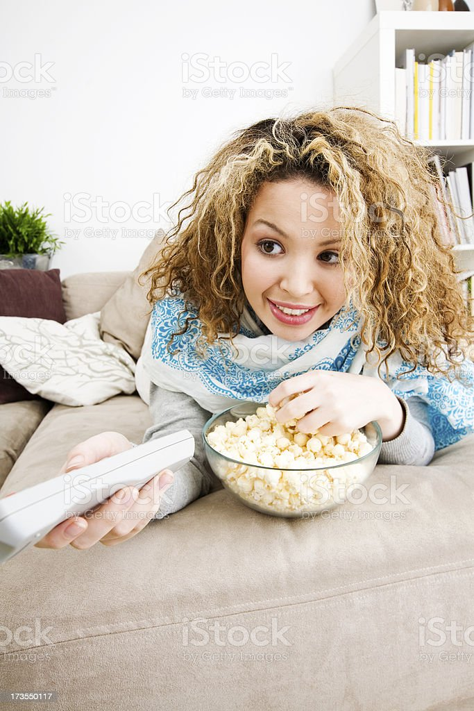 Teenage girl with remote control royalty-free stock photo