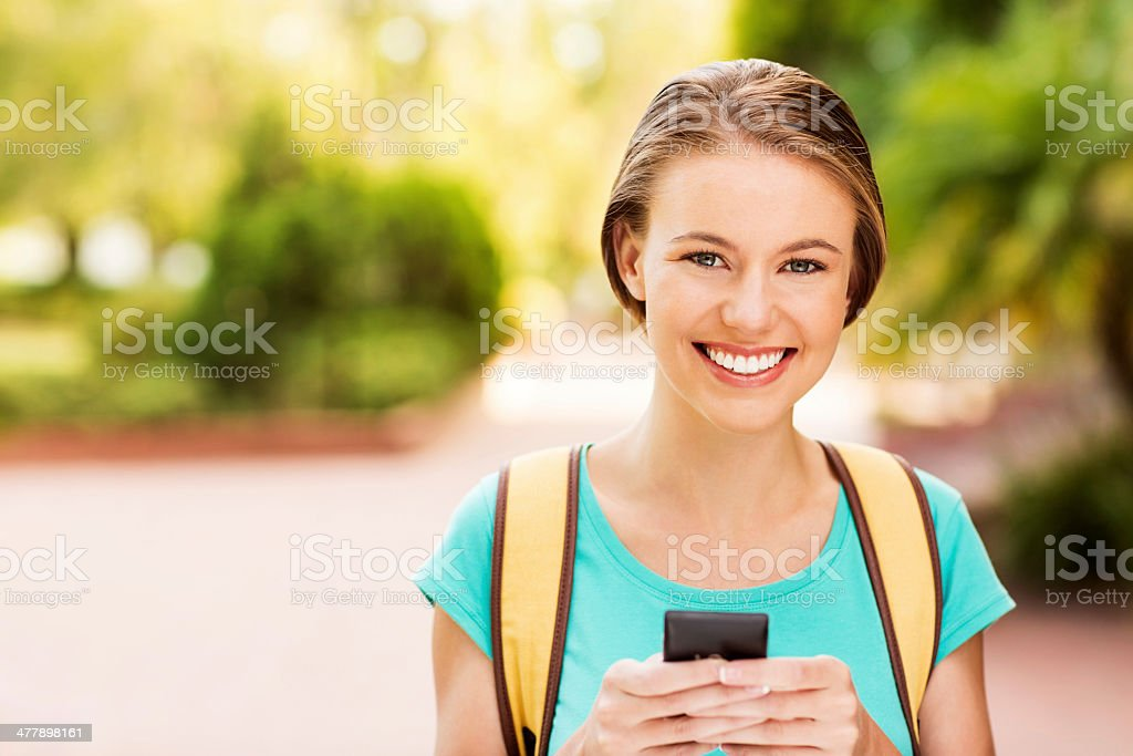 Teenage Girl With Smart Phone On College Campus royalty-free stock photo