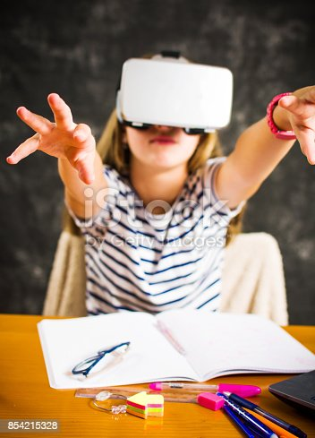 Teenage girl having fun with virtual reality glasses