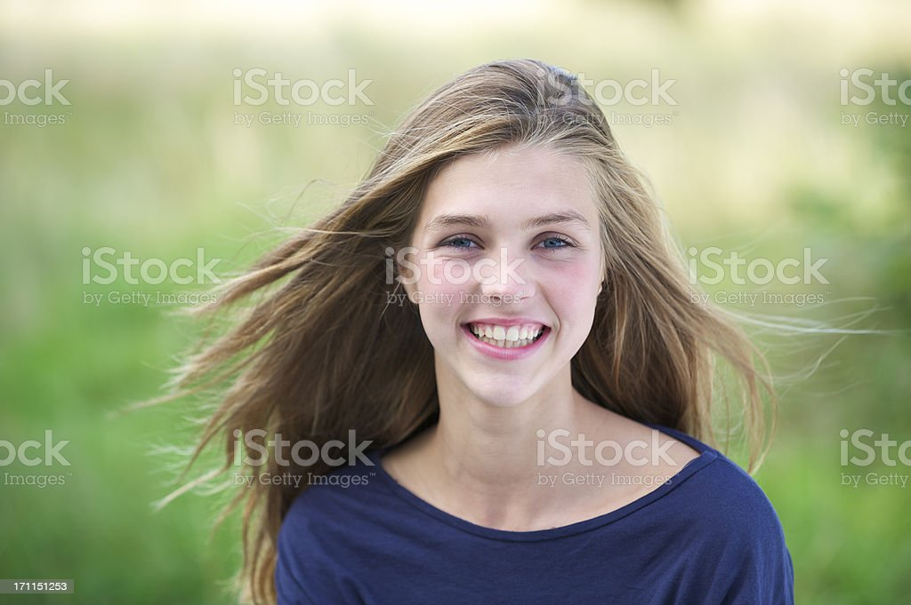 Teenage girl with wind in her hair stock photo