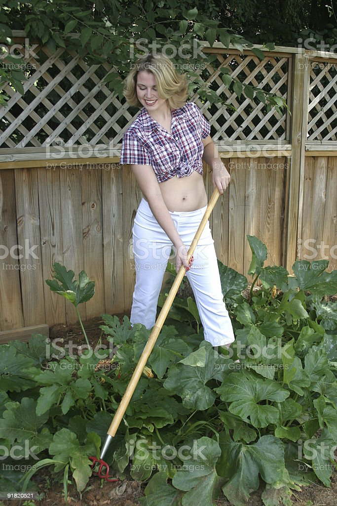 Teenage girl working in a vegtable garden royalty-free stock photo