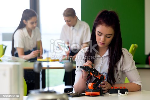 istock Teenage Girl Working on Robotic Arm 538356310