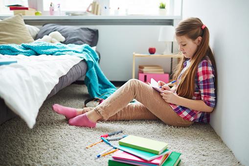 Teenage Girl Writing Diary