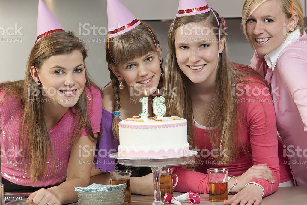 teenage girls celebrating 16th birthday stock photo