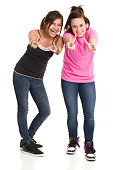 Two excited happy teenage girls give peace signs. http://s3.amazonaws.com/drbimages/m/dr.jpg