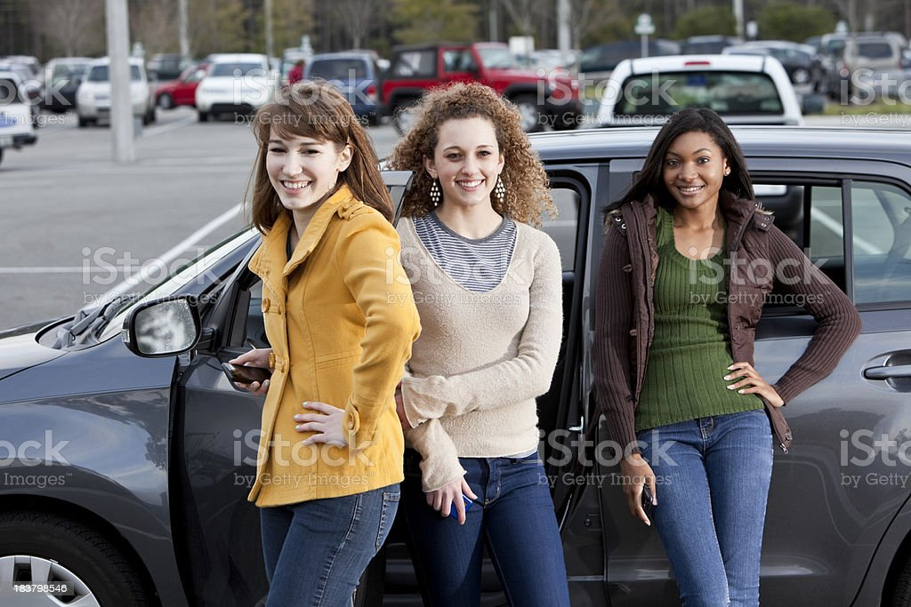 Teenage girls hanging out in parking lot royalty-free stock photo