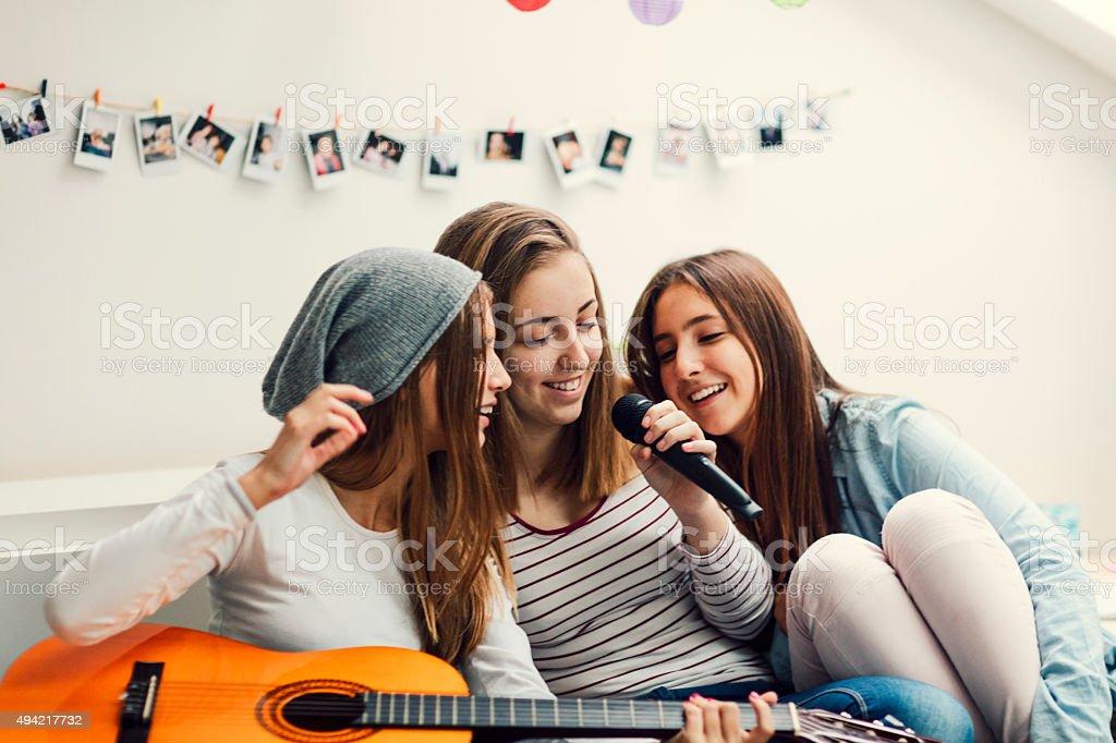 Teenage Girls Has Karaoke Party. stock photo