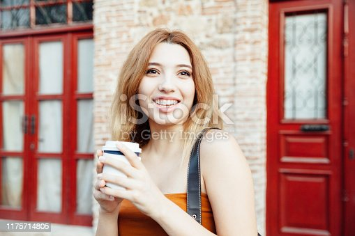 531098549 istock photo Teenage girls holding coffee cup 1175714805