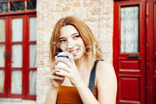 531098549 istock photo Teenage girls holding coffee cup 1175716890