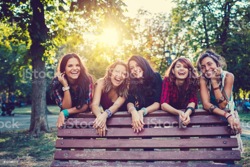 Teenage girls in the park smiling to the camera stock photo