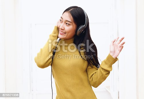 istock Teenage girls listening music with headphones, happiness and enjoying music concepts. 825521338