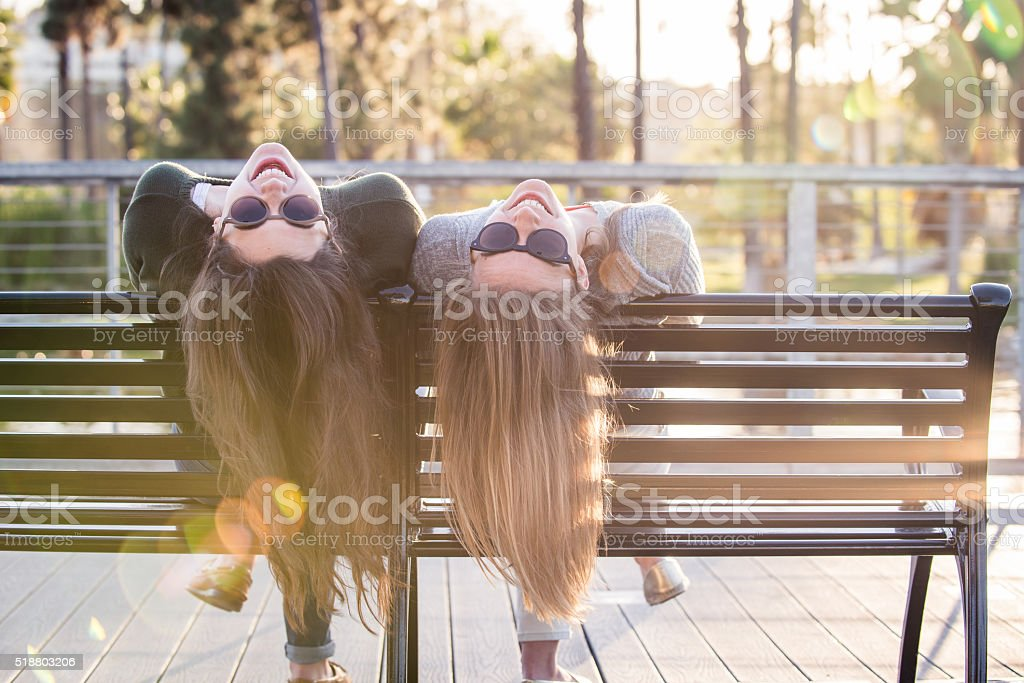 Teenage Girls on a Park Bench stock photo