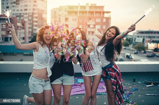 istock Teenage girls on a rooftop party 484076586