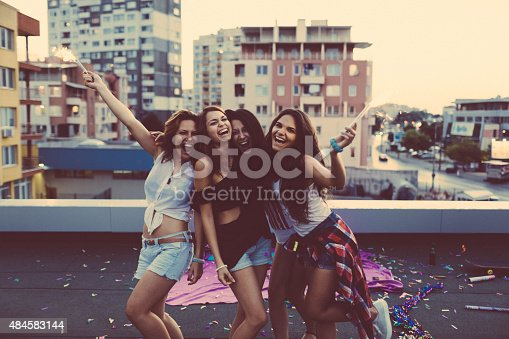 istock Teenage girls on a rooftop party 484583144