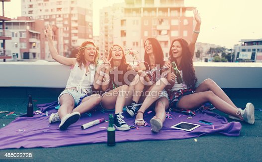 699427744 istock photo Teenage girls on a rooftop party 485022728