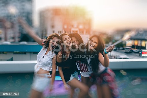 istock Teenage girls on a rooftop party 485022740
