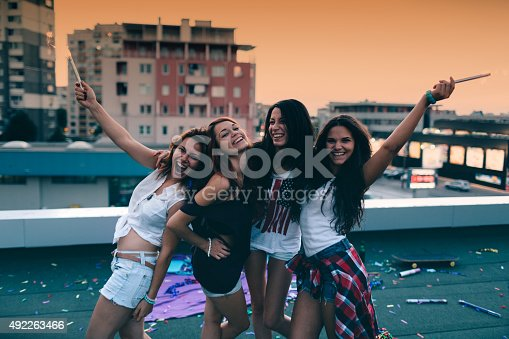 699427744 istock photo Teenage girls on a rooftop party 492263466