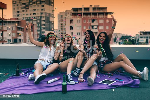 istock Teenage girls on a rooftop party 492671528