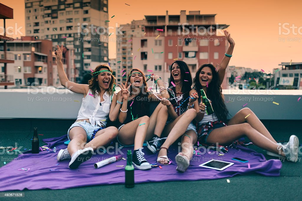 Teenage girls on a rooftop party stock photo