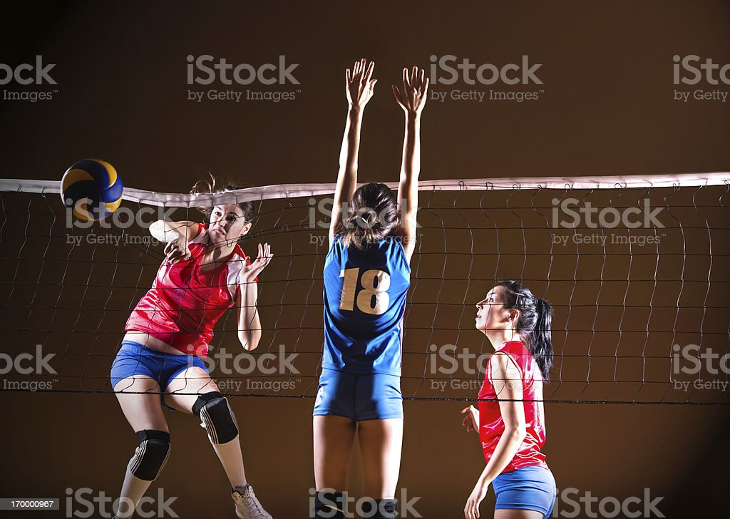Teenage girls playing volleyball. royalty-free stock photo