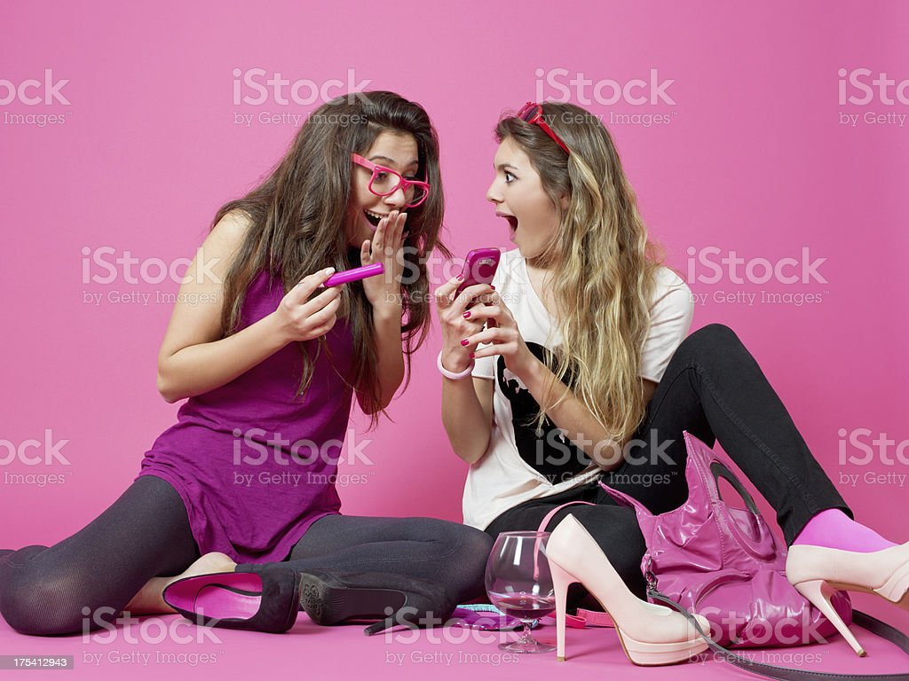 Teenage girls playing with cell phones royalty-free stock photo