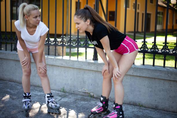 Teenage girls rollerblading stock photo